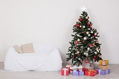 Christmas tree in the room with Christmas decorations and gifts toys. Winter royalty free stock photos