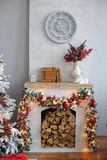 Christmas Tree in Room, Xmas Home Night Interior. Christmas home decoration with tree, gifts and fireplace Royalty Free Stock Images