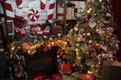 Christmas Tree in Room, Xmas Home Night Interior. Christmas home decoration with tree, gifts and fireplace Stock Image