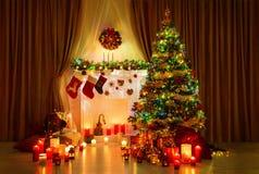 Christmas Tree Room, Xmas Home Night Interior, Fireplace Lighs. Christmas Tree in Room, Xmas Home Night Interior, Fireplace Lights Decoration, Hanging Socks stock image