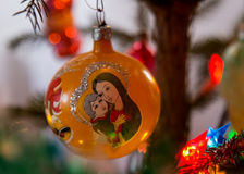 Christmas tree`s toy pained. Christmas glass toy `Jesus Maria` on the Christmas tree Royalty Free Stock Photos