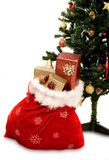 Christmas tree with sack full of gifts Stock Photo
