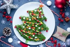 Christmas Tree Salad For Festive Dinner On Table With Decoration Royalty Free Stock Photo