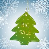 Christmas tree sale tag on a snowy background Stock Photos