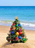 Christmas tree on sand in beach Stock Images
