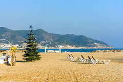 Christmas tree on sand beach. In Sitges, Spain royalty free stock photo