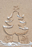 Christmas Tree in the Sand with Snow. Christmas Tree made in the Sand with snow spray on it Royalty Free Stock Photo