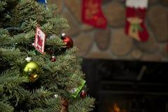 Christmas Tree with Santa Card and stockings. An evergreen Christmas Tree with a printed Santa Claus card ornament and Christmas stockings Stock Photos