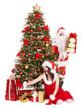 Christmas tree, santa claus, girl and gift box. Royalty Free Stock Photography