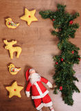 Christmas tree, Santa Claus and toys on a wooden background with empty space. Christmas tree, Santa Claus and textile toys on a wooden background with empty Stock Photos