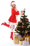 Christmas tree and santa girl Royalty Free Stock Image