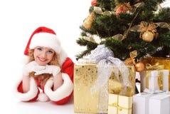 Christmas tree and santa girl Royalty Free Stock Photo
