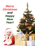 Christmas tree and santa girl Stock Photo