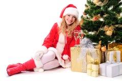 Christmas tree and santa girl Stock Photos