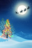 Christmas tree and Santa in moonlit winter landscape Royalty Free Stock Photo