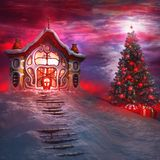 Christmas tree and Santa's house Royalty Free Stock Photos