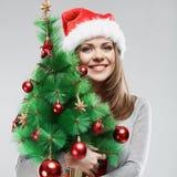 Christmas tree ,  santa woman portrait. Royalty Free Stock Photo