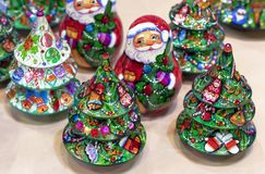 Christmas tree and Santa wooden holiday decorations stock photos