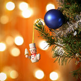 Christmas tree scene. Christmas tree with hanging figure on golden background Royalty Free Stock Photo