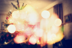 Christmas tree scene in living room with festive bokeh Stock Photos