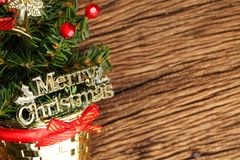 Christmas tree scene. The miniature christmas tree with decoration ornament put on hard wood background represent the christmas theme concept related idea Royalty Free Stock Image