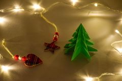 Christmas tree with scottish heart and star on yellow warm light royalty free stock photography