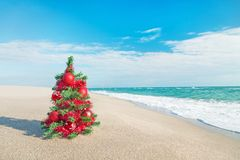 Christmas tree on the sea beach. Christmas vacation concept. Royalty Free Stock Photo