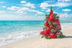 Christmas tree on the sea beach. Christmas vacation concept. Royalty Free Stock Photos