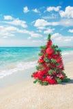 Christmas tree on the sea beach. Stock Photo