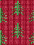 Christmas tree seamless knitted pattern. Green pixel images with red background. Vector illustration Stock Image