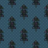 Christmas tree seamless pattern. On a dotted dark blue background Royalty Free Stock Photo