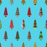 Christmas tree seamless pattern over cyan. Christmas tree seamless vector pattern with colourful ornate decoration as a Celtic tartan plaid over cyan background Royalty Free Stock Photo