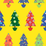 Christmas tree seamless pattern over yellow Royalty Free Stock Images