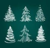 Christmas tree set. Christmas tree hand drawn set on dark green background Royalty Free Stock Photos
