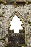 Christmas tree shape in a castle's window Stock Images