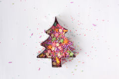 Christmas tree shape cookie cutter with sugar sprinkles royalty free stock photos