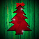 Christmas Tree Shape cut on Green Wall Royalty Free Stock Images