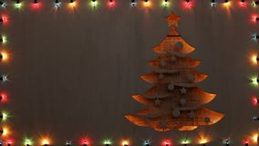 Christmas tree shape with fading colorful xmas lights frame, copy space stock video footage