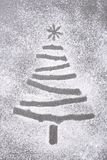 Christmas tree shape in flour sprinkled on a baking sheet Royalty Free Stock Photography
