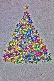 Christmas tree shape made of colorful stars. grunge filter applied Royalty Free Stock Photo