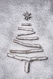 Christmas tree shape made of twigs and sprinkled with flour Stock Images