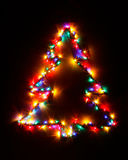 Christmas tree shape of multicolor garland lights Royalty Free Stock Image