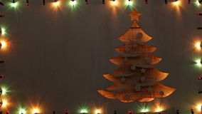 Christmas tree shape surrounded with colorful xmas lights frame, copy space stock video footage