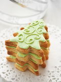 Christmas tree shaped biscuits. Homemade Christmas sugar cookies glazed with royal icing. Selective focus Royalty Free Stock Photography