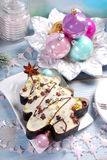 Christmas tree shaped cake with icing and sprinkles Royalty Free Stock Photos