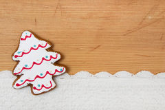 Christmas tree shaped cookie, crocheted snow on wooden backgroun Stock Images