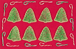 Christmas tree shaped cookies surrounded by candy cane border on Stock Image