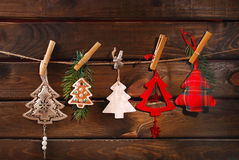 Christmas tree shaped decoration collection hanging on twine Stock Images
