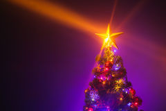 Christmas tree with shining star and dense mist Royalty Free Stock Photo