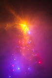 Christmas tree with shining star and dense smoke Stock Image